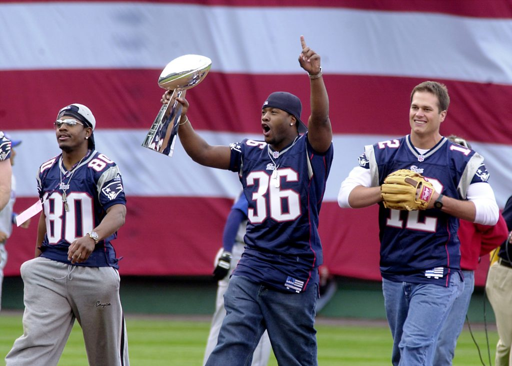 4/1/02 - MWDN -  Patriots Troy Brown (80), left, Lawyer Milloy (36) and Tom Brady (12) walk onto the field at Fenway Park to throw ou the first pitch at opening day Monday in Boston. staff photo by Suzanne Ouellette
