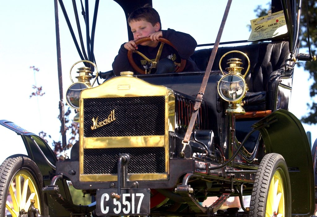 8/24/03 :: BARD :: Matthew Hare, 6, of Canterbury waits behind the wheel of his grandfather's 1907 Maxwell RL Tour-A-Bout during the Annual Northeastern Connecticut Chamber of Commerce Car Show at the Plainfield Memorial School in Plainfield Sun., August 24, 2003.  Hare's grandfather, Dick Baril of Brooklyn, was talking to attendees about his car as Matthew Hare and, his brother, Zachary, 8, waited for his company at the car show.  (Suzanne Ouellette/photo)